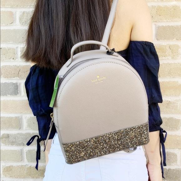 kate spade Handbags - Gaby'sBags👜💕- Kate Spade Glitter Backpack Gray